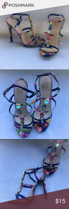 """💐Heart In D Floral Heels With Gems💐 Absolutely gorgeous springtime heels in great condition. Size 7 but I do personally feel that they run small. I wear a size 7 and these are a little to tight in the toe area for me. 5"""" heel height. No defects to them except that the bottoms show that they have been worn (with the black bottoms that's barely noticeable). No shoe box with purchase. I'm only looking to sell at this time so sorry but no trades. Heart In D Shoes Heels"""