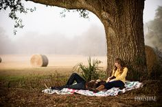 Southern engagement with couple cuddling under a tree - Footstone Photography