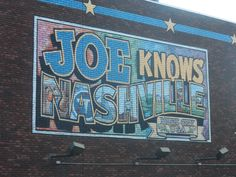 Urban Advertising and Art 00042 - a colourful painted mural on the side of a restaurant over re brickwork in a cartoon style - Downtown, Nashville, Tennessee
