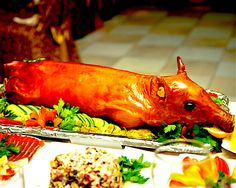 Citizens, as we approach the New Year, my mind of course wanders to the most celebratory dishes one might serve at this most festive time of year. ...and what is more festive than a whole roast suckling pig, especially prepared in the spicy tradition of the Indonesian Island of Bali? :) Babi guling is a roasted pig stuffed with chili, turmeric, garlic, and ginger, amongst other fragrant leaves, herbs and spices. My version can be made in a home oven and is truly amongst the most succulent…