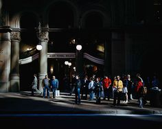 Trent Parke I love how most of the image is quite dark but there is a small streak of light highlighting only the people in the image