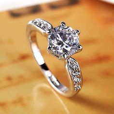 Lissome Six Prong 2CT Round Cut White Sapphire Engagement Ring