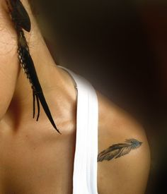 small feather shoulder tattoo