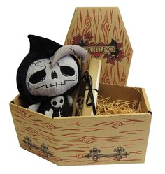 Grimwold Reaperling sat on a bed of wood wool in his very own coffin box with his Undead Certificate <3 http://www.myfrightlings.com/gifts/undead-plush/grimwold-reaperling-undead-plush.html