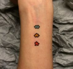 MY ALL TIM FAVORITE TATTOO I HAVE DONE! Three puzzle pieces. Very tiny tattoo. For autism. I have lots of requests for this now