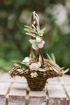 Adorable rustic flower girl basket, decorated with petite blooms and greenery. #wedding #flowers