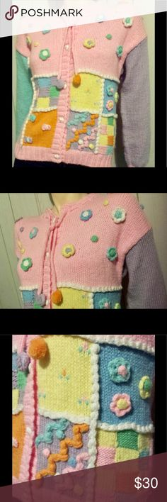 """Cutesy VTG 80s JORDACHE Pastel Colorblock Sweater Adorable vintage 80s pastel colorblock soft acrylic knit sweater by JORDACHE. Button down front w/white heart shaped buttons,cut full at shoulders. Flowery crochet appliques on front w/patchwork design & crochet trim. Drawstring neckline w/pom poms. Very colorful & sweet as candy, a true 80s delight.   SZ:L Bust:38-40"""" 30"""" across bottom Lgth:App 24"""" sh-hem  Slv Lgth:20"""" Label:Jordache  Material:100% Acrylic  Condition:EX/Top button hole is a…"""