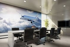 Huge wall mural of a plane in a board room. Wall Graphics