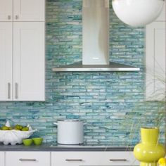 Stunning glass backsplash in cool ocean hues.