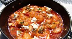 Shrimp Saganaki is served as an appetizer, and is accompanied by ouzo or wine. It is easy to prepare and if you like nibbling seafood with a glass of wine, this will be your dish! Saganaki is the special small pan with two handles that is used for pr Greek Recipes, Fish Recipes, Seafood Recipes, Greek Fish, Food To Make, Shrimp, Curry, Food Porn, Food And Drink