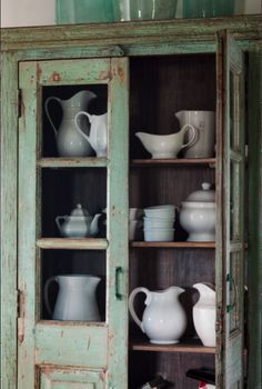 Ironstone collection in a beautiful old cupboard