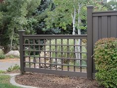 I like the look of this open lattice fence and how it connects to the taller privacy fence.