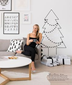 use washi tape and felt garland to make a Christmas tree on the wall - see story starting page 90
