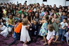 Children help President Barack Obama to his feet