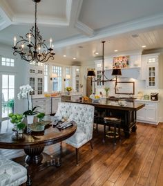 white kitchen, darker floors