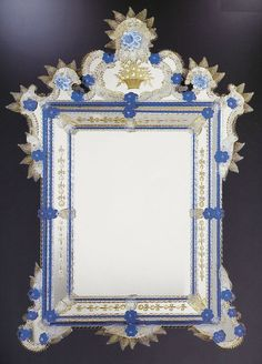 Century Venetian Mirror A beautiful Murano mirror hand-etched with sandstone wheels and smartly decorated with striking blue glass trims. All mirrors in this range are available in antique mirror as well as the original finish. Vintage China, Vintage Wood, Frame, Blue Glass, Venetian Mirrors, Murano Mirrors, Mirror, Gilded Mirror, Venetian