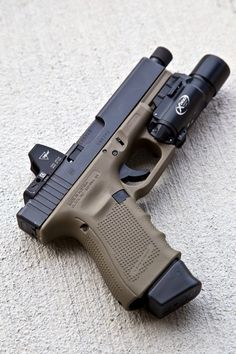 Glock 19 Gen 4 in FDE with threaded barrel, Surefire X300, and Trijicon RMR. This will be my set up very soon, just got to find the dang gun. Find our speedloader now! http://www.amazon.com/shops/raeind