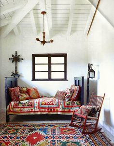 painted window frame, and I also like the daybed/bench look, and the quilt, haha