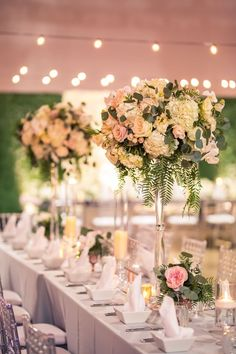 Floral Centerpieces Decor | This couple had a stunning wedding at The Garage Burbank. The florals were stunning with a floor to ceiling flower wall in the reception plus tall centerpieces. This bride and groom had a nightmare story but with the help of a