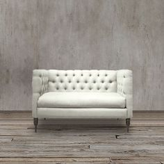 This is a handsome loveseat upholstered in linen and viscose.  Featuring a tufted back in classic tuxedo style, this piece works great in the library or as a banquette bench