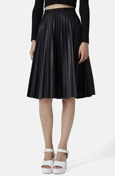 Crisp pleats topped by a slender grosgrain waistband define an inky midi skirt cut in an A-line silhouette.
