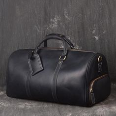 Vintage Full Grain Leather Travel Bag, Large Duffle Bag, Overnight Bags Model Number: Dimensions: x x / 50 cm(L) x 23 cm(W) x 26 cm(H) Weight: lb / kg Hardware: Brass Hardware Shoulder Strap: Adjustable & Removable Color: Dark Brown / Black Features: