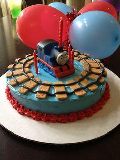 Thomas the train birthday cake. Graham cracker train tracks.