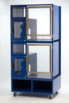 All metal modular cat condo/cage in beautiful blue. Available in over 100 colors with storage bin, separate litter area, resting shelf, lockable wheels and decorative design. Perfect for animal shelter adoption areas.