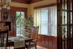 Our dining room after restoration. This woodwork was painted when we bought the house. We made the leaded glass panels and stenciled curtains. Laurelhurst Craftsman Bungalow: Alex Vertikoff's Photos