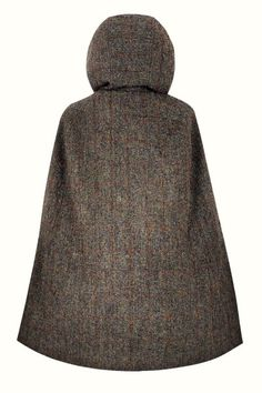 Hepburn Earth Hooded - Luxuriously crafted in a classic brown & green Harris Tweed, this timeless cape embodies the country chic lifestyle and offers an elegant replacement to your classic cool weather jacket. With its large, slouched hood, this cape will be the perfect choice for outerwear all year around. Capes For Women, Harris Tweed, Fashion Line, Country Chic, Stylish Outfits, Vintage Inspired, Hoods, Turtle Neck, Weather