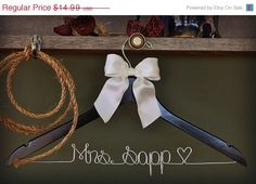 SALE- ON SALE- Personalized Wedding Hanger / bridesmaid gifts / name hanger / brides hanger/. $13.99, via Etsy.