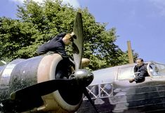 Mechanics prepare an RAF plane for a daylight bombing raid over Occupied France//Robert Capa Navy Aircraft, Ww2 Aircraft, Military Aircraft, Wellington Bomber, Ww2 Planes, Royal Air Force, Royal Navy, World War Ii, Wwii
