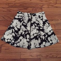 Awesome floral skater skirt Pins and Needles black & white floral print skater skirt with a zipper down the front. From urban outfitters and in great condition. Urban Outfitters Skirts Circle & Skater
