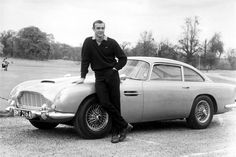 The original James Bond Sean Connery, with his Aston Martin (True Story: I met a girl in college named Astin Martin. Not after the car though. But I totally thought she should try to be a Bond Girl. Sean Connery James Bond, Aston Martin Db5, James Bond Cars, James Bond Movies, Steve Mcqueen, 007 Contra Goldfinger, Ford Mustang, Film Cars, Personal Development