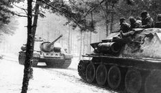 A column of SU-100 and SU-85 on the March in East Prussia. January 1945.