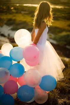 Loverly! Pinks, blues, whites in balloons with a lovely white dress.