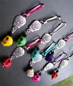 An amazing array of sweet baby sugar skulls in 8 different colors. These adorable baby skulls are connected to double sided silver sugar skull charms. Cute Baby Girl, Cute Babies, Halloween Jewelry, Mexican Folk Art, Sugar Skulls, Zipper Pulls, Girl Stuff, Beads, Pendant