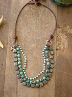 Bohemian statement necklace, turquoise necklace multi strand, artisan bronze, knotted, leather sundance, beach chic heart charm dangle. $80.00, via Etsy.