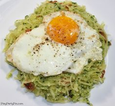 Spaghetti squash with pesto, bacon, and a fried egg from playpartypin.com  Just drop the bacon . . .