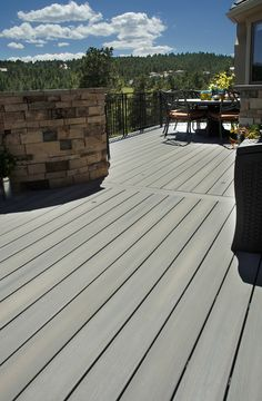 'Green Living' with eco-friendly composite decking. This is Fiberon's Horizon line, in Greystone. Fiberon composite decking is made from recycled plastic and lumber mill scraps. Using these materials means we prevent more than 50,000 tons of plastic and other waste from ending up in landfills or incinerators.