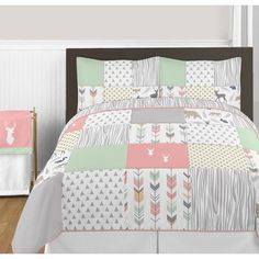 Woodsy Comforter Set will help you create an incredible room for your child. This stylish designer bedding set uses an impressive array of exclusive fabrics combining arrow, triangle, metallic dot, wood grain and woodland animal prints. The design uses brushed microfiber and cotton fabrics that are machine washable for easy care. This wonderful set will fit full and queen or twin size beds.