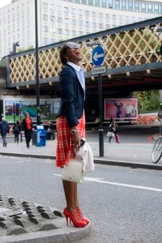 Sightsee in style in a plaid skirt and navy blazer. And remember... a smile is always the best accessory!