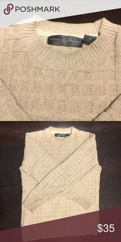 Oscar De La Renta classic fisherman sweater This authentic classic from the late Oscar de la Renta is a true heritage piece you'll want to wear over and over again. Oscar de la Renta Sweaters Crewneck