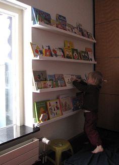 I might like this even better than the rain gutter idea for kids' books in the playroom.