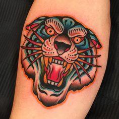 A vibrant tiger head by Samuele Briganti (IG—samuelebriganti - Tattoo MAG Tiger Hand Tattoo, Hand Tattoos, Forarm Tattoos, Sleeve Tattoos, Arabic Tattoos, Traditional Sailor Tattoos, Traditional Panther Tattoo, Traditional Tattoo Design, Tatuaje Old School