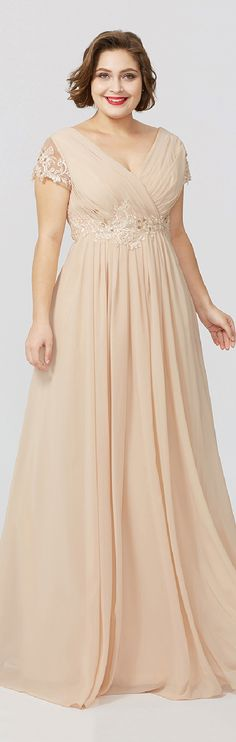 This sleek plus-size jersey sheath gown stays on-trend with beading,appliques,pleats details.