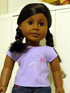 I just received my new doll.  I named her Ebonita.  She is so much prettier than the photos of her at the American Girls Store online.  Her skin color is much darker and a beautiful shade.    She has