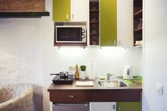 Truly tiny kitchen with hot plate and mini-appliances.