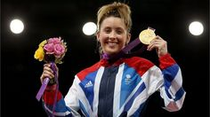 Jade Jones of Great Britain celebrates with her gold medal