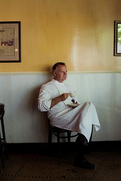 Photo Credit: William Hereford. Chef Frank Stitt takes a sip and a rare moment of rest.
